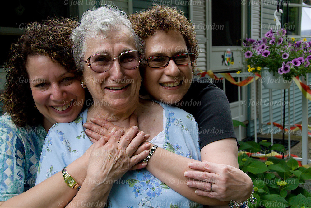 Head and shoulder portrait of Michele, Minnie and Caryn. Photo was taken at outdoor 80th birthday party.