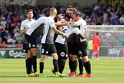 Junior Morias of Peterborough United is mobbed by team-mates after scoring to make it 2-0 - Mandatory by-line: Joe Dent/JMP - 26/08/2017 - FOOTBALL - Sixfields Stadium - Northampton, England - Northampton Town v Peterborough United - Sky Bet League One