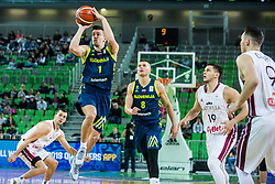 Matic Rebec of Slovenia  and Edo Muric of Slovenia with Rihards Lomazs of Latvia during basketball match between National teams of Slovenia and Latvia in Round #10 of FIBA Basketball World Cup 2019 European Qualifiers, on December 2, 2018 in Arena Stozice, Ljubljana, Slovenia. Photo by Grega Valancic