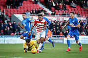 Doncaster Rovers forward Mallik Wilks takes it round Peterborough Utd goalkeeper Conor O'Malley (25) but couldn't finish during the EFL Sky Bet League 1 match between Doncaster Rovers and Peterborough United at the Keepmoat Stadium, Doncaster, England on 9 February 2019.