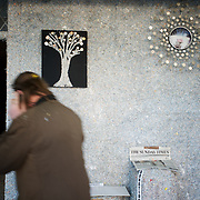 Ireland: Irish artist Frank Buckley passes by in his Billion Euro House art installation in central Dublin. ..Worthless euros, taken out of circulation and shredded by Irelands Central Bank, formes the interior walls of an apartment that Mr. Buckley does not own in a building left vacant by the countrys economic ruin...The artist decided to call the apartment  built from thousands of bricks of shredded, decommissioned cash (each brick contains, roughly, what used to be 50,000 euros)  the Billion Euro House. He reckons that about 1.4 billion euros actually went into it, but the joke, of course, is that it is worth simultaneously so much and so little...A large gravestone beside the main door, announces that Irish sovereignty died in 2010, the year that the government accepted an international bailout so larded with onerous conditions that the Irish will be paying for it for years to come. (Paulo Nunes dos Santos/Polaris)