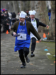 Lord Redesdale (left) and Tim Loughton MP takes part in the MP's and Lords race against political Journalist in the Rehab Parliamentary Pancake Shrove Tuesday race a charity event which sees MPs and Lords joined by media types in a race to the finish. Victoria Tower Gardens, Westminster, Tuesday February 12, 2013. Photo By Andrew Parsons / i-Images