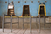 Train ticket windows stand vacant at the dilapidated and desolate railway station in Battambang, Cambodia.