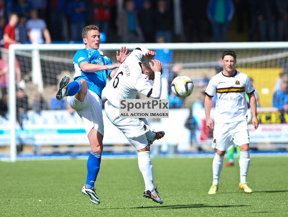 Dumbartons Chris turner takes a clash to the head after a challenge with QOS Stephen McKenna