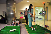 Ilona Bistrian (8) plays mini-golf during the Children;s Medical Center 100th anniversary party in Dallas on Wednesday, April 3, 2013. (Cooper Neill/The Dallas Morning News)