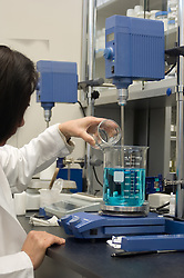 Chemist mixing a formula in a laboratory