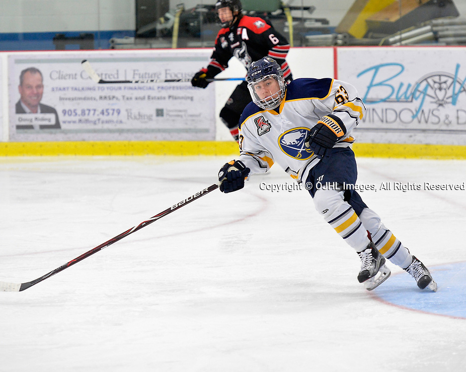 GEORGETOWN, ON  - NOV 4,  2017: Ontario Junior Hockey League game between the Georgetown Raiders and Buffalo Jr. Sabres. Michael Sciore #63 of the Buffalo Jr. Sabres follows the play during the second period.<br /> (Photo by Shawn Muir / OJHL Images)
