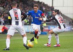 Rangers' James Tavernier (centre) and St Mirren's Ryan Edwards battle for the ball during the Ladbrokes Scottish Premier League match at St Mirren Park, St Mirren.