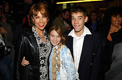 Writer KATHY LETTE and her children GEORGIE ROBERTSON and JULIUS ROBERTSON at the opening night of the musical Murderous Instincts at The Savoy Theatre, London on 7th October 2004.<br />