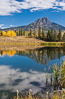 Reflections of 11,871 Potato Hill in a small lake in the San Juan Mountains, Colorado.