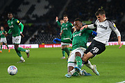 Derby County midfielder Jason Knight (38) crosses the ball under pressure from Sheffield Wednesday defender Moses Odubajo (22) during the EFL Sky Bet Championship match between Derby County and Sheffield Wednesday at the Pride Park, Derby, England on 11 December 2019.