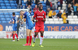 Gabriel Zakuani of Gillingham celebrates victory at full-time as Marcus Maddison of Peterborough United cuts a dejected figure - Mandatory by-line: Joe Dent/JMP - 14/10/2017 - FOOTBALL - ABAX Stadium - Peterborough, England - Peterborough United v Gillingham - Sky Bet League One