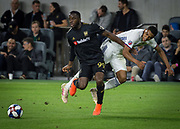LAFC forward Adama Diomande (99) and FC Dallas defender Reggie Cannon (2) in action during a MLS soccer match against the FC Dallas in Los Angeles, Thursday, May 16, 2019. LAFC defeated FC Dallas 2-0.  (Ed Ruvalcaba/Image of Sport)
