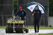 ICC third umpire Allan Haggo and the groundstaff check the field as the rain pours down and threatens to stop the One Day International match between Scotland and Afghanistan at The Grange Cricket Club, Edinburgh, Scotland on 10 May 2019.