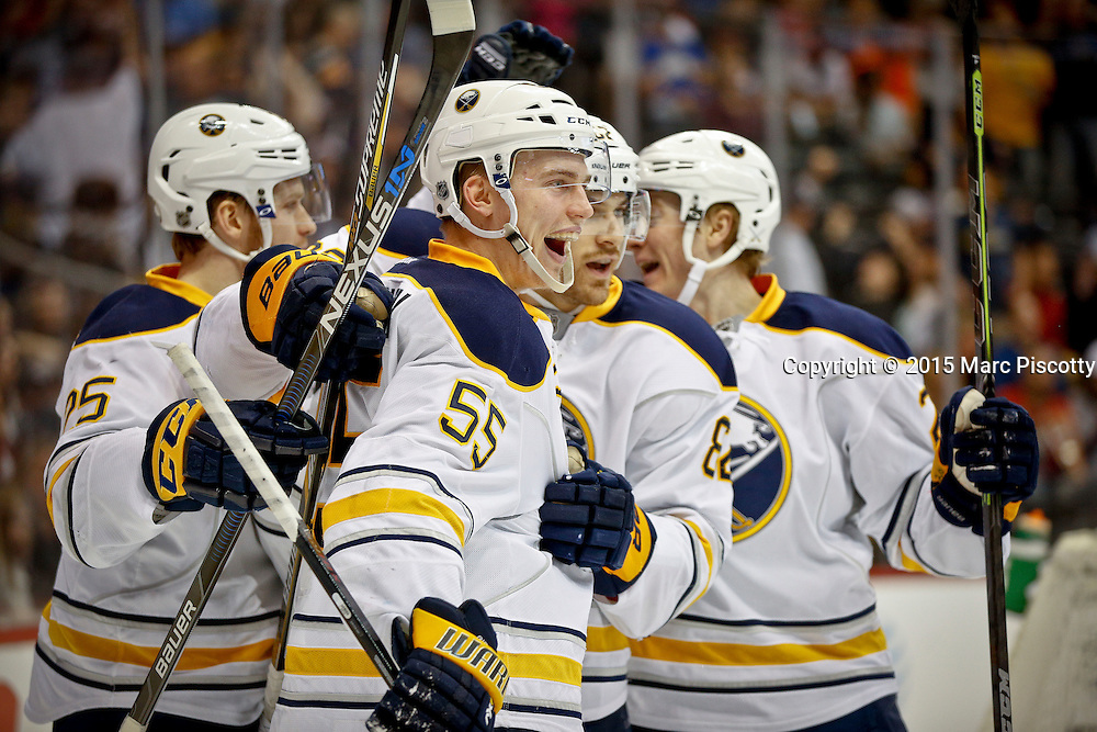 SHOT 3/28/15 9:07:20 PM - The Buffalo Sabres' Rasmus Ristolainen #55 celebrates with teammates after scoring a goal against the Colorado Avalanche during their regular season NHL game at the Pepsi Center in Denver, Co. The Avalanche won the game 5-3. (Photo by Marc Piscotty / © 2015)