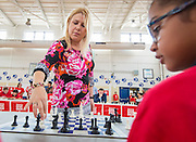 Arial Baker watches chess grandmaster Susan Polgar make a move during their game at Ryan Middle School, September 15, 2014.