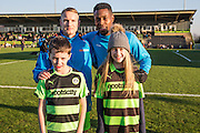 The mascots with Forest Green Rovers Marcus Kelly(10) and Forest Green Rovers Dale Bennett(6) during the Vanarama National League match between Forest Green Rovers and Braintree Town at the New Lawn, Forest Green, United Kingdom on 21 January 2017. Photo by Shane Healey.