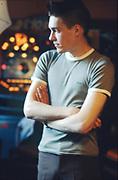 Man stood in pub in Highgate, London, UK, 1980s.