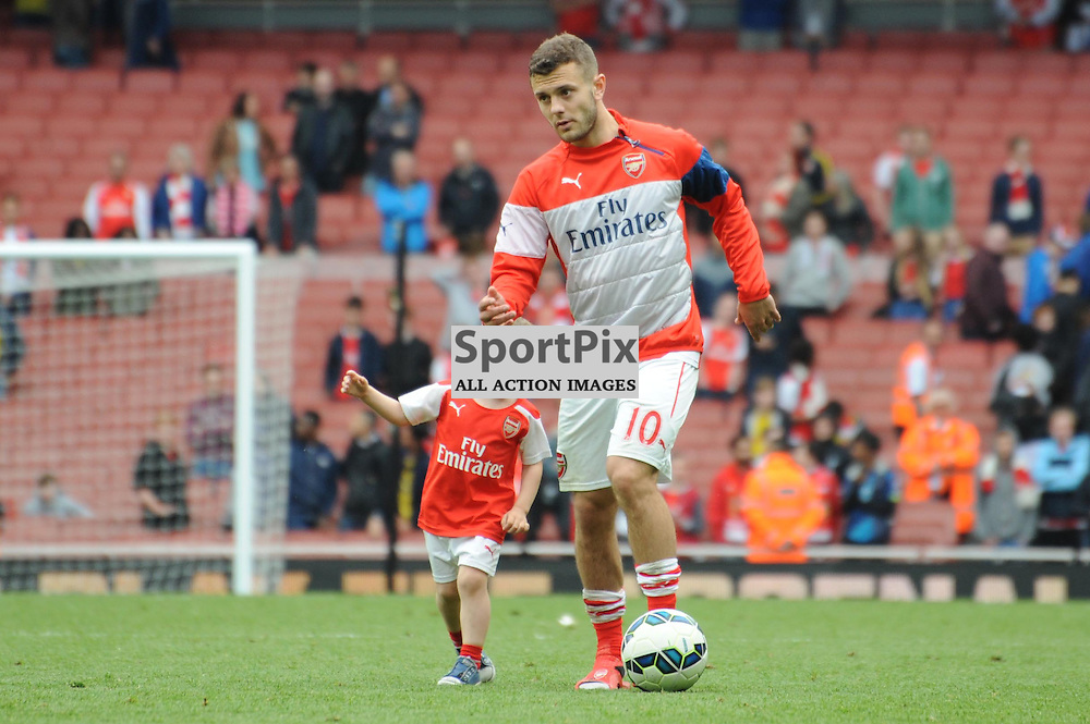 Arsenals Jack Wilshere and Son Archie on the pitch during the lap of honour after Arsenal v West Brom match on Sunday 24th May 2015