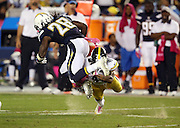 San Diego Chargers running back Melvin Gordon (28) gets tackled by Pittsburgh Steelers cornerback Antwon Blake (41) as he tries to jump over the tackle attempt during the 2015 NFL week 5 regular season football game against the Pittsburgh Steelers on Monday, Oct. 12, 2015 in San Diego. The Steelers won the game 24-20. (©Paul Anthony Spinelli)
