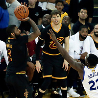 12 June 2017: Cleveland Cavaliers guard Kyrie Irving (2) takes a jump shot over Golden State Warriors forward Draymond Green (23) during the Golden State Warriors 129-120 victory over the Cleveland Cavaliers, in game 5 of the 2017 NBA Finals, at the Oracle Arena, Oakland, California, USA.