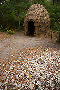 A replica Timucuan Indian dwelling with an oyster midden in the foreground found within Fort Caroline National Memorial. Fort Caroline memorializes the short-lived French presence in sixteenth century Florida.