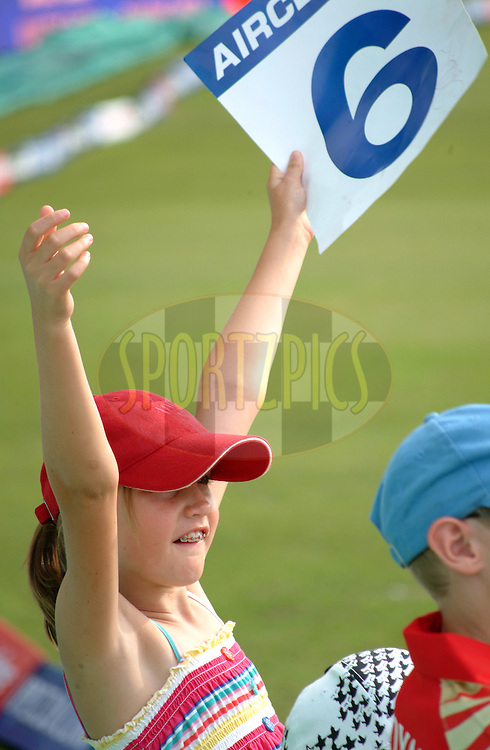 DURBAN, SOUTH AFRICA - 23 April 2009.  It's a six - a young fan loving the action