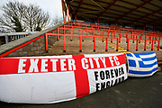 Supporters flags on the Big Bank before the EFL Sky Bet League 2 match between Exeter City and Grimsby Town FC at St James' Park, Exeter, England on 29 December 2018.