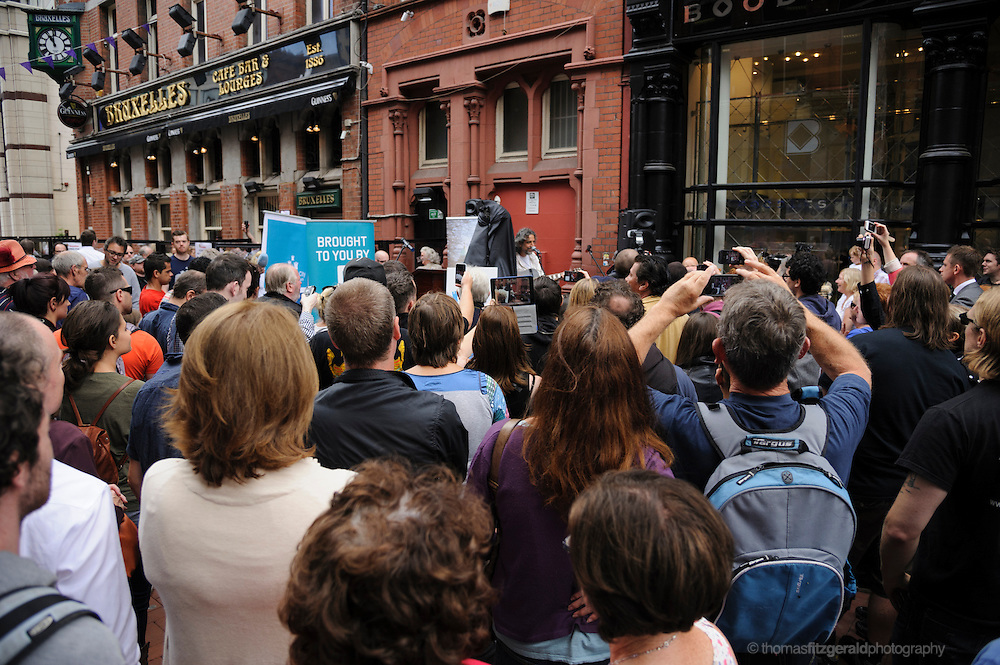 Dublin, Ireland, August 2013: Crowds gather on Harry Street for Phil Lynott Statue Unveiling.<br /> <br /> The Statue is being unveiled, having being repaired following damage by vandals earlier this year. Several musicians played at the event and the star's mother, Philimena Lynott gave a moving speech about her Son and the Statue.<br /> <br /> EDITORIAL ONLY EDITORIAL ONLY