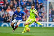 Lewis Stevenson (#16) of Hibernian FC shields the ball from Scott Arfield (#37) of Rangers FC during the Ladbrokes Scottish Premiership match between Rangers FC and Hibernian FC at Ibrox, Glasgow, Scotland on 5 May 2019.