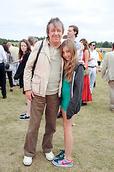 BILL WYMAN and his daughter MATILDA WYMAN at the Veuve Clicquot Gold Cup polo final held at Cowdray Park, Midhurst, West Sussex on 18th July 2010.