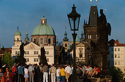 CZECH REPUBLIC BOHEMIA PRAGUE JUL97 - Passers-by and tourists gather on Charles Bridge.  . . jre/Photo by Jiri Rezac. . © Jiri Rezac 1997. . Tel:   +44 (0) 7050 110 417. Email: jiri@jirirezac.com. Web:   www.jirirezac.com