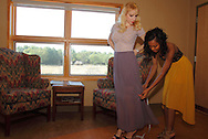 Model Nadia Yaroshenko of Huber Heights (left) gets measured by designer Jamila Jones of Dayton during a Dayton Fashion Week meeting at SunWatch Indian Village/Archaeological Park in Dayton, Saturday, July 21, 2012.