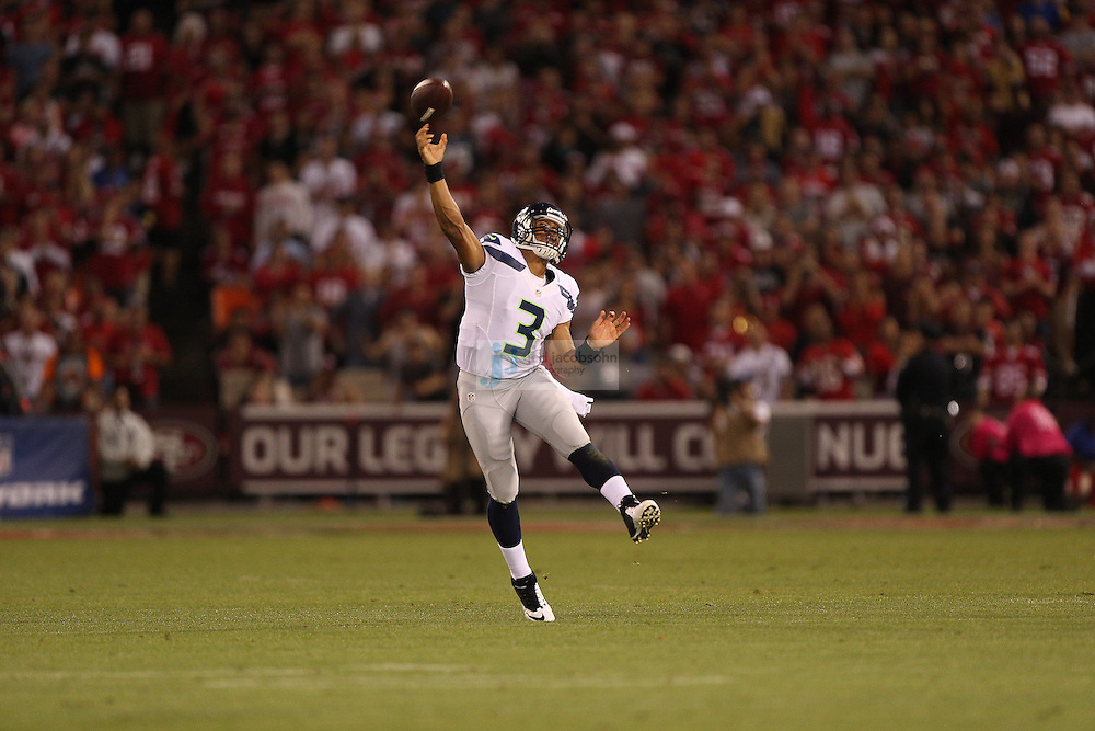 Seattle Seahawks quarterback Russell Wilson (3) passes against the San Francisco 49ers on Thursday, Oct. 18, 2012 at Candlestick Park in San Francisco. (AP Photo/Jed Jacobsohn)