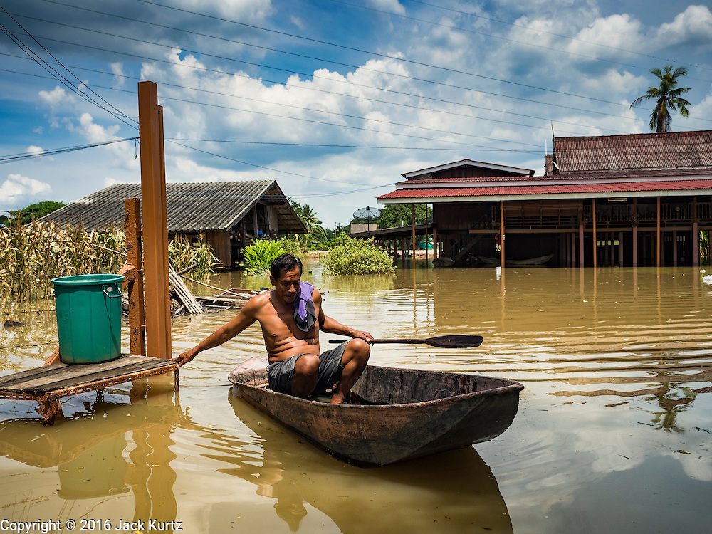 30 SEPTEMBER 2016 - SAI NOI, AYUTTHAYA, THAILAND:  A farmer who lost his banana and corn crops to floods from the Chao Phraya River leaves his flooded home in Sai Noi. The Chao Phraya River, the largest river that runs through central Thailand, has hit flood stage in several areas in Ayutthaya and Ang Thong provinces. Villages along the river are flooded and farms are losing their crops due to the flood. This is the same area that was devastated by floods in 2011, but the floods this year are not expected to be as severe. The floods are being fed by water released from upstream dams. The water is being released to make room for heavy rains expected in October.     PHOTO BY JACK KURTZ
