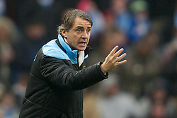 MANCHESTER, ENGLAND - Sunday, January 8, 2012: Manchester City's manager Roberto Mancini during the FA Cup 3rd Round match against Manchester United at the City of Manchester Stadium. (Pic by David Rawcliffe/Propaganda)