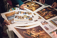 Refugees pick out posters from Concordia Publishing House following a Bible study on Friday, Nov. 13, 2015, near the Evangelisch-Lutherische St. Trinitatisgemeinde, a SELK Lutheran church in Leipzig, Germany. LCMS Communications/Erik M. Lunsford
