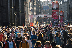 Edinburgh, Scotland, UK. 15 August 2019. Warm sunny weather in Edinburgh brought thousands of tourists onto the Royal Mile to enjoy the many street performers and actors promoting their shows during the Edinburgh Festival Fringe. Pictured; Thousands of tourists on the Royal Mile. Iain Masterton/Alamy Live News ++ Editorial Use Only ++