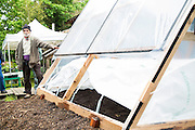 Demo of a greenhouse at Bean Mountain Farms on Saturday, May 17, 2014, in Fayetteville, Ark. Photo by Beth Hall