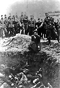 The Final Solution to the Jewish Question: An Einsatzgruppe D soldier about to shoot a Jew kneeling at a partially filled mass grave in Vinnitsa, Ukrainian SSR, Soviet Union, in 1942.  The Einsatzgruppen were SS paramilitary task forces whose main purpose was the extermination of Jews.