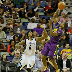 Feb 1, 2016; New Orleans, LA, USA; New Orleans Pelicans guard Toney Douglas (16) shoots over Memphis Grizzlies guard Mario Chalmers (6) during the second quarter of a game at the Smoothie King Center. Mandatory Credit: Derick E. Hingle-USA TODAY Sports