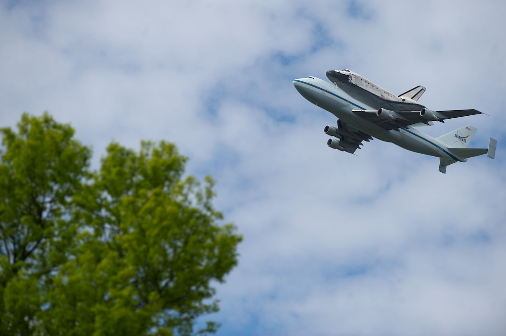 The Space Shuttle Discovery flies over Washington on Tuesday, April 17th, 2012 as viewed from near the Iwo Jima statue in Arlington, VA. (Photo by Jay Westcott/Politico)