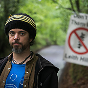 Adam Raynor lives on and off in the camp and has been involved in environmental campaign in the South East for years.  He is worried about the proposed fracking for oil in Leith Hill, where the oil will be extracted using acidisation, very similar to the technique used in gas fracking. Europa Oil and Gas company has got license to drill for oil in the woods near Leith Hill.  Proetctors of the land, a group of local campaigners against the proposed drilling and activists have set up a community camp on Coldharbour Lane to  protect Leith Hill from the unconventional oil exploration, through monitoring, awareness raising, and peaceful community action.