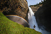 A hiker at the base of Helmcken Falls, Wells Gray Provincial Park, British Columbia