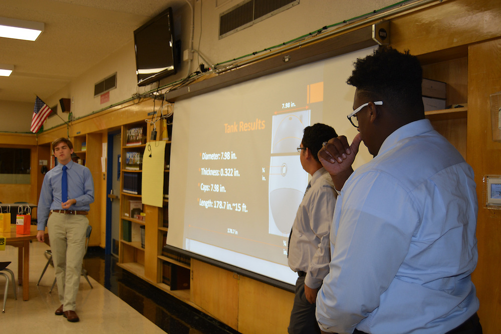 Members of Booker T. Washington's Golden Eagle Rocket teams present the results of their trip to White Sands Missile Range in New Mexico.