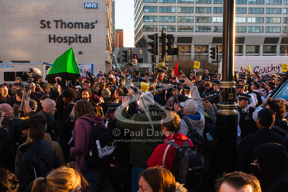 London, March 7th 2015. Following the Climate march through London, masked anarchists and environmental activists clash with police following a breakaway protest at Shell House. PICTURED: Dozens of protesters and police officers clash on Westminster Bridge.