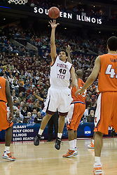 Virginia Tech Hokies forward A.D. Vasallo (40) gets a shot off against Illinois.  The #5 seed Virginia Tech Hokies defeated the #12 seed Illinois Illini 54-52 in the first round of the Men's NCAA Tournament in Columbus, OH on March 16, 2007.