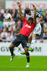 Man Utd Midfielder Luis Antonio Valencia (ECU) and Swansea Defender Ben Davies (WAL) compete in the air during the first half of the match - Photo mandatory by-line: Rogan Thomson/JMP - Tel: Mobile: 07966 386802 17/08/2013 - SPORT - FOOTBALL - Liberty Stadium, Swansea -  Swansea City V Manchester United - Barclays Premier League - First round of the 2013/14 season and the first league match for new Man Utd manager David Moyes.