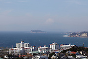 Zushi-shi¬+in the Hiroyama-Kouen prefecture with in the background a snow covered Mt Fuji