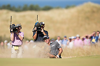 Golf - 2013 Open Championship at Muirfield - Friday Round Two<br /> Lee Westwood of England gets himself out of a bunker on the approach to the 5th green